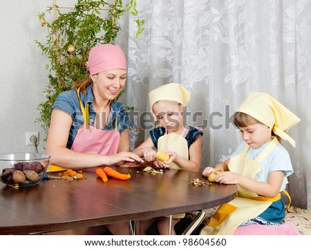 A woman shows how to clean vegetables - stock photo