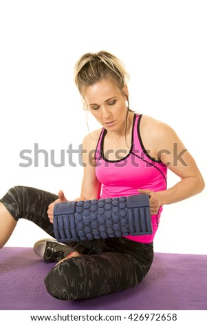 A woman sitting and looking at her roller. - stock photo