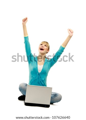 A woman sitting with a laptop is holding hands up, isolated on white