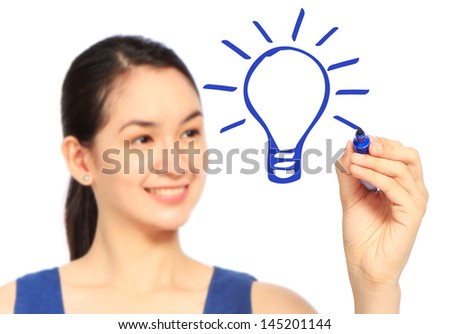 A woman sketching a light bulb on a whiteboard