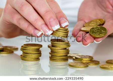 a woman stacked coins. save money for the future.