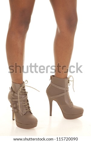 a woman standing with her brown boots on. - stock photo