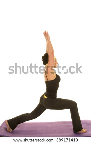 A woman stretching her body out doing a yoga stretch. - stock photo
