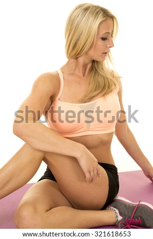 A woman stretching on her fitness mat showing off her flexibility.