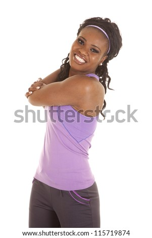 a woman stretching out her arm with a smile on her face - stock photo