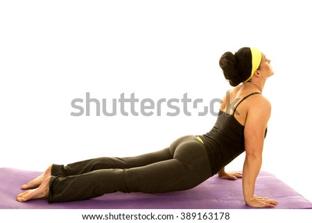 a woman stretching out her body doing a yoga pose. - stock photo