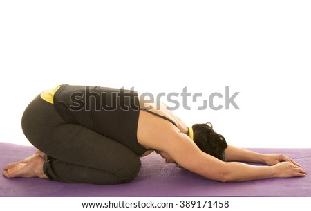 a woman stretching out her body in child's pose. - stock photo