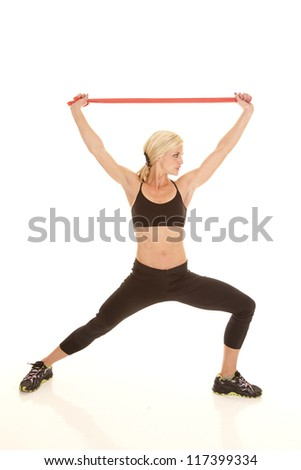 A woman stretching out using a rubber band. - stock photo