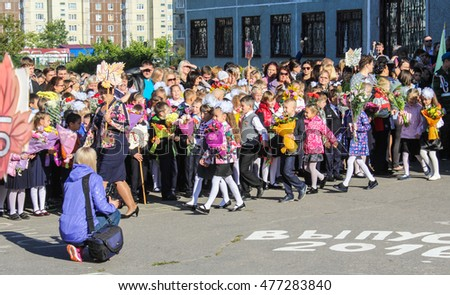 A woman takes pictures of children. St. Petersburg, Russia - 1 September, 2016. School holiday the Day of Knowledge.