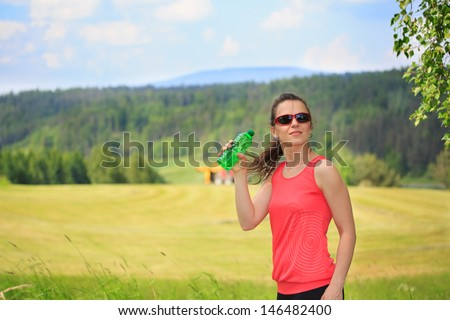 A woman taking a break from running - stock photo
