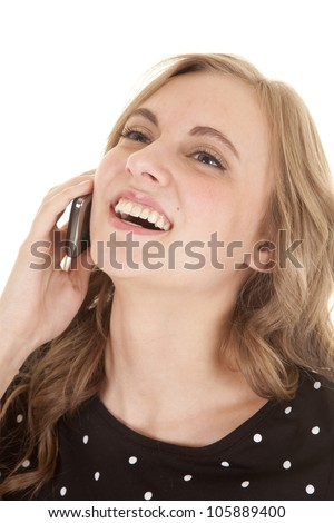 A woman talking and laughing on her cell phone. - stock photo