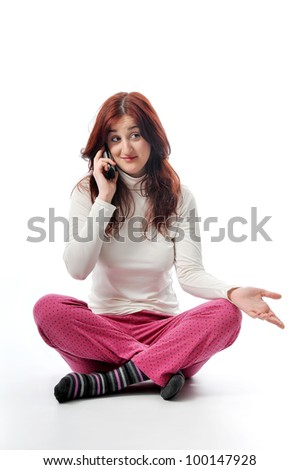 a woman talking her phone - stock photo