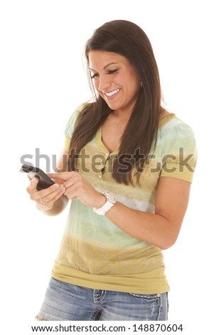 a woman texting on her phone, with a smile on her face.