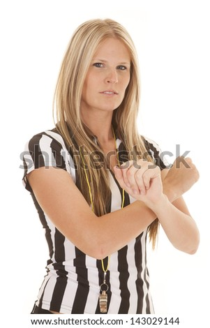 a woman that is serious in he referee out fit making a call