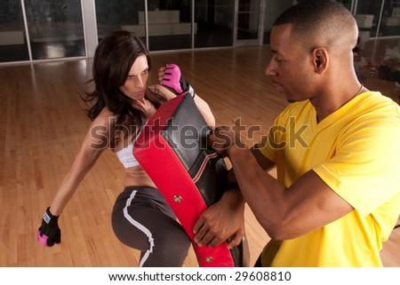 a woman trains at kickboxing or self defense - stock photo