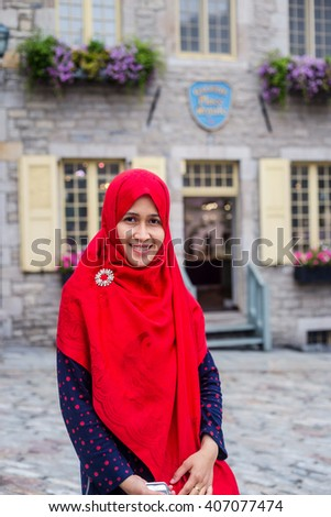 A woman travel in Old Quebec City - stock photo