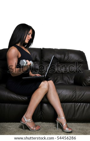 A woman using a computer while working out - stock photo