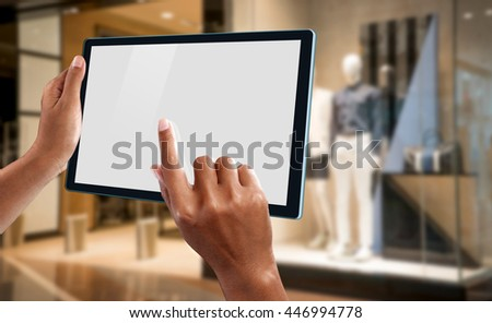 A woman using a tablet to make online shopping - stock photo