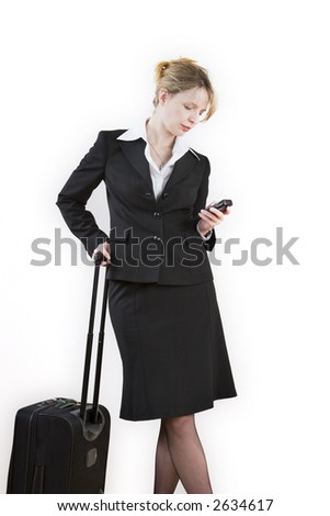 A woman waiting with a suitcase