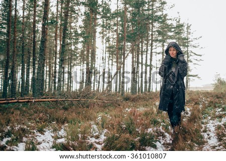 A woman walking through a forest