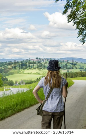 a woman walking through nature/walk/nature - stock photo