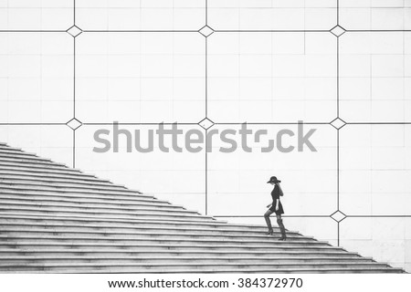 A woman walking up the stairs. - stock photo