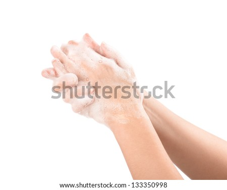 A woman washes her hands with soap. Isolated on white. - stock photo