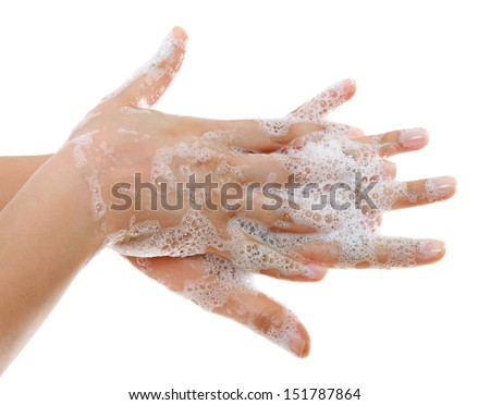 A woman washing her hands with a soap suds  - stock photo