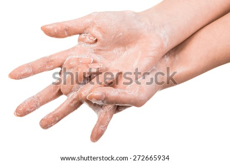 A woman washing her hands with a soap suds. - stock photo