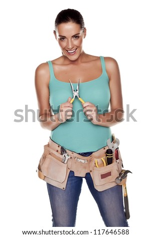 A woman wearing a DIY tool belt full of a variety of useful tools on a white background. DIY woman. - stock photo