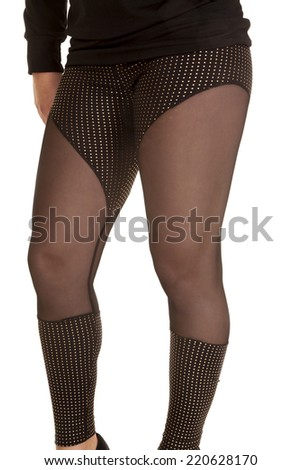 A woman wearing her sheer leggings showing off her legs. - stock photo