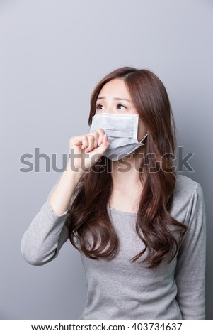 A Woman wears a mask and look something, illness, asian beauty,gray background