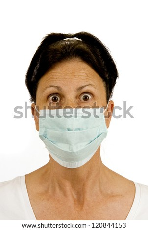 A woman wears a surgical mask to protect her from germs.