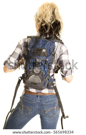 A woman with a backpack on and her hiking clothes ready for the hike.