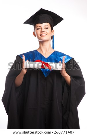 A woman with a degree in her hand as she looks at the camera