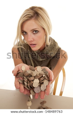 A woman with a handful of loose change.