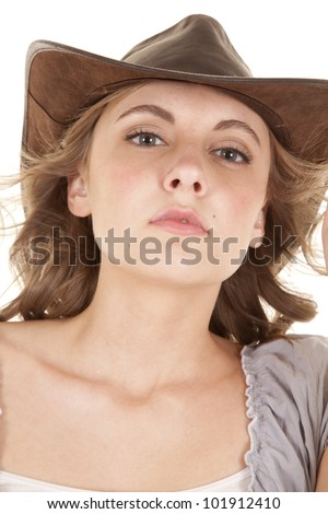 A woman with a hat on and a serious expression. - stock photo