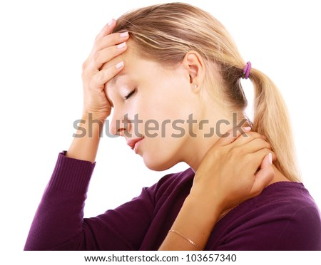 A woman with a headache holding head, isolated on white background - stock photo