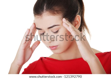 A woman with a headache holding temples, isolated on white background