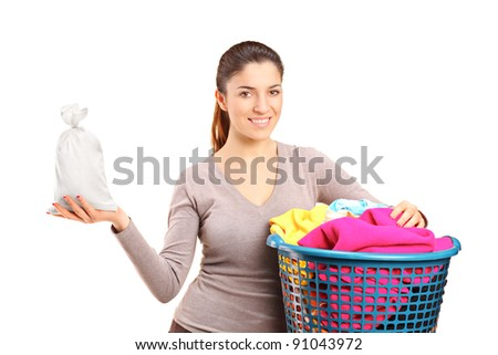 A woman with a laundry basket holding a money bag isolated on white background