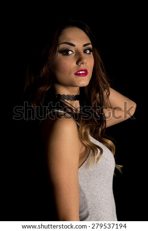 A woman with a sensual expression on her face. - stock photo