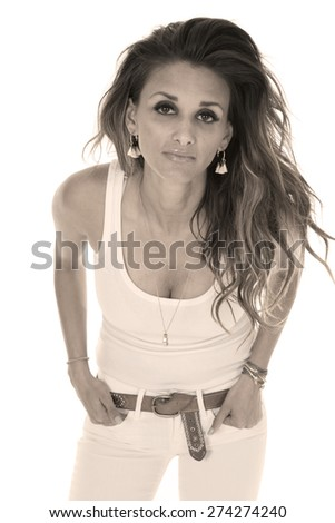 a woman with a serious expression in her all white clothing. - stock photo