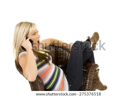 a woman with a shocked expression on her face talking on her cell phone. - stock photo