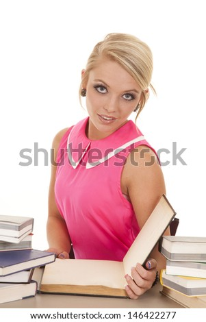 a woman with a small smile on her lips studying her book