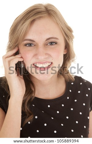 A woman with a smile on her face talking on the cell phone. - stock photo