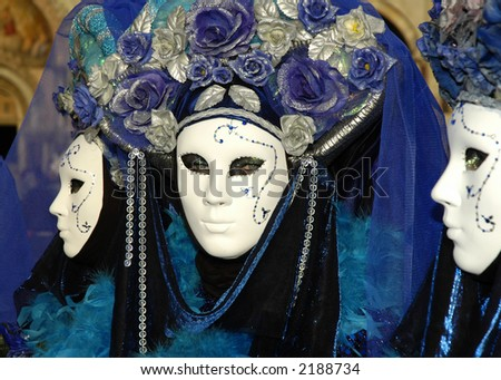 a woman with beautiful eyes looks out from behind a mask at Carnivale in Venice,Italy - stock photo