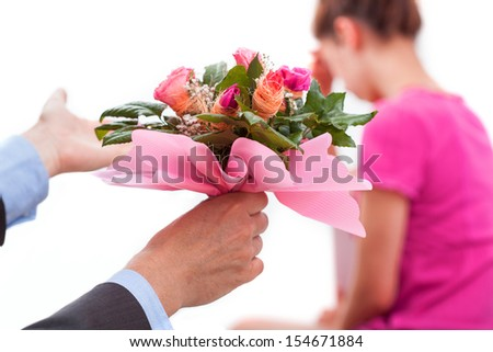 A woman with broken heart and man with flowers wanted forgiveness  - stock photo