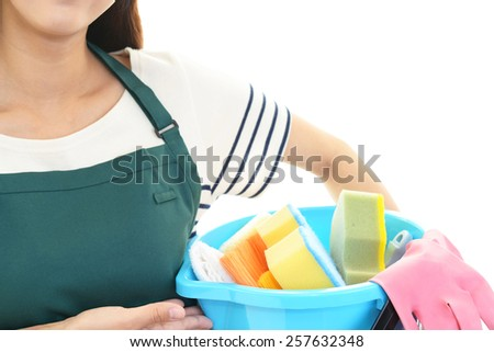 A woman with cleaning tools - stock photo