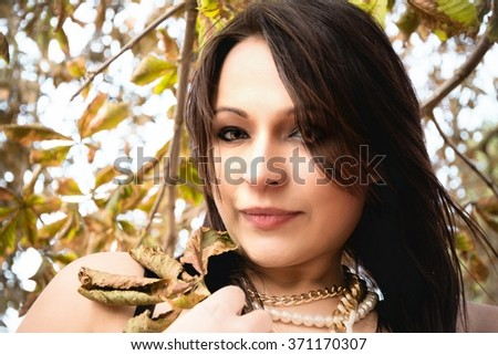 A Woman with deciduous leaf in autumn