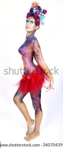 A woman with extreme full-face body painting poses on a white background. Carnival concept  - stock photo